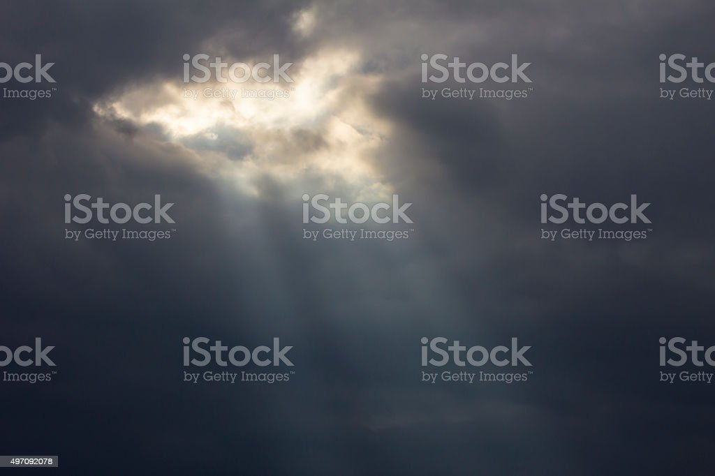 Sunbeam breaking through the cloudy sky stock photo