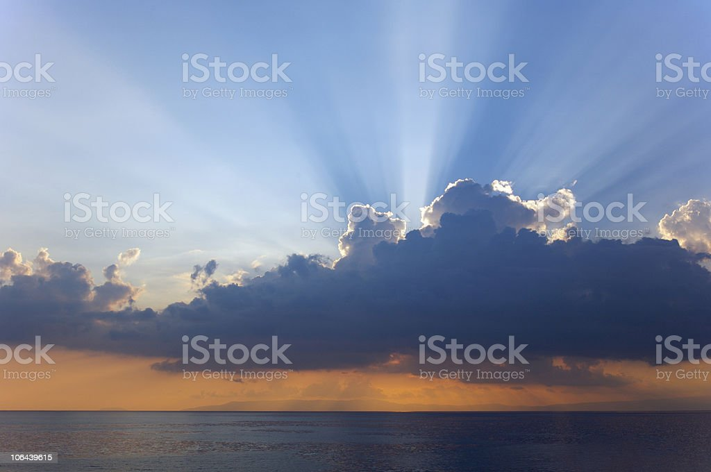 Sunbeam from clouds stock photo