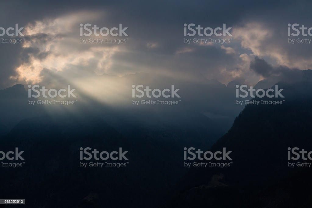 Sunbeam in dark sky stock photo