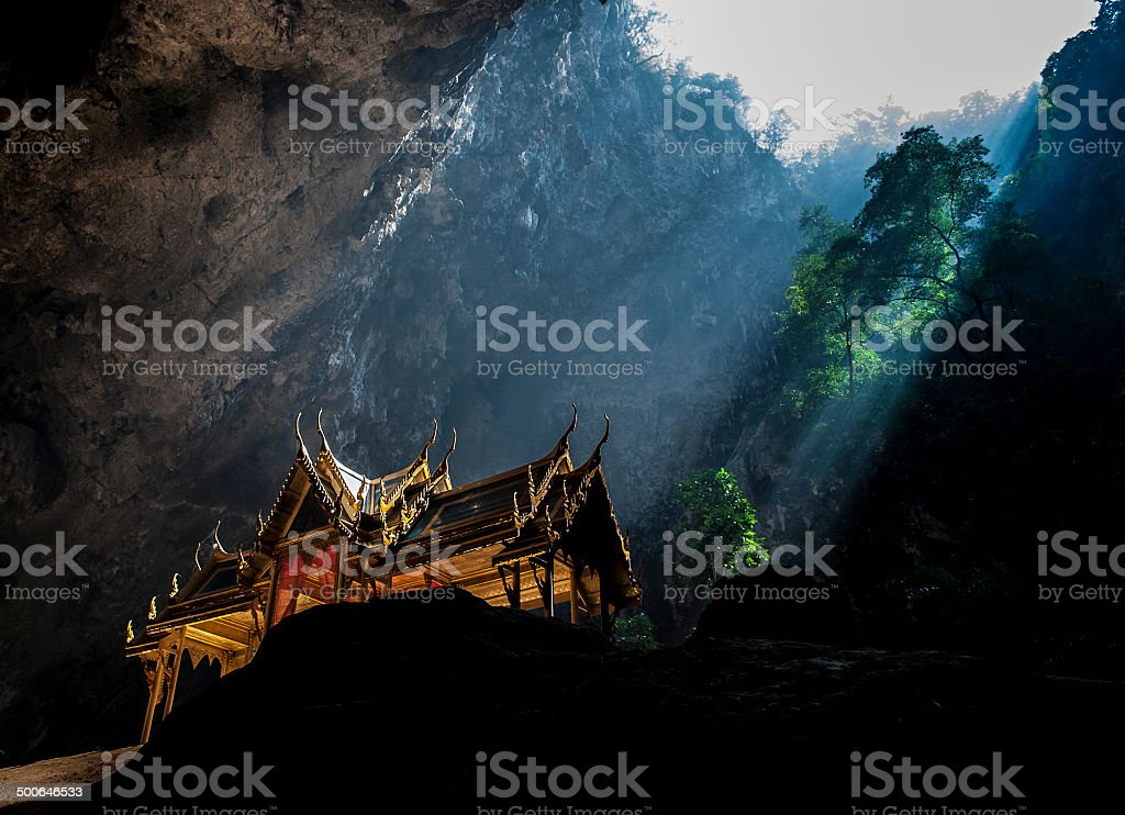 Sunbeam on the golden pavillion in a cave (close-up view) stock photo