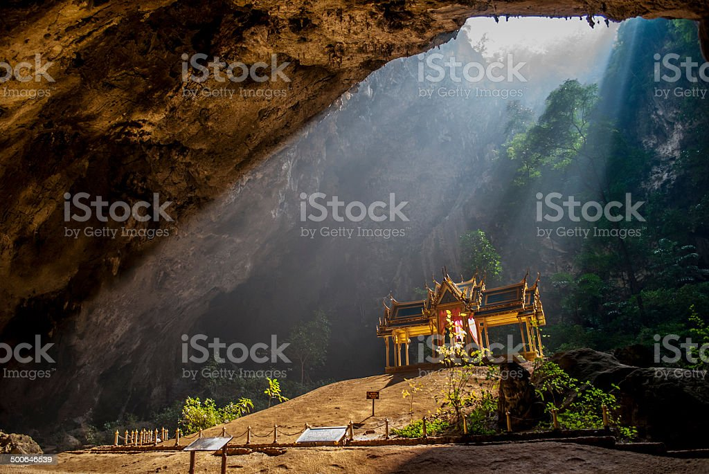 Sunbeam on the golden pavillion in a cave stock photo
