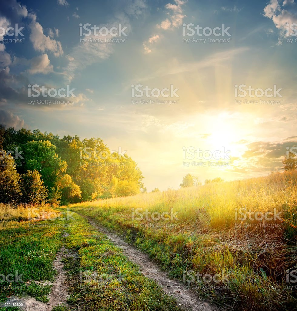Sunbeams and country road stock photo