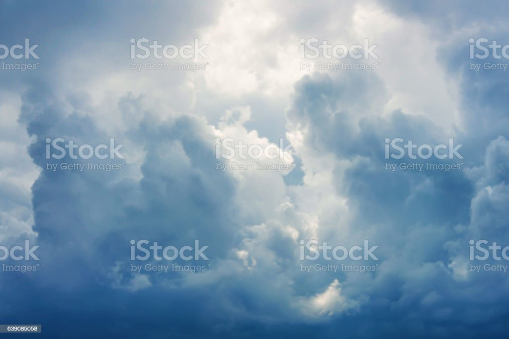 Sunbeams falling from the clouds stock photo