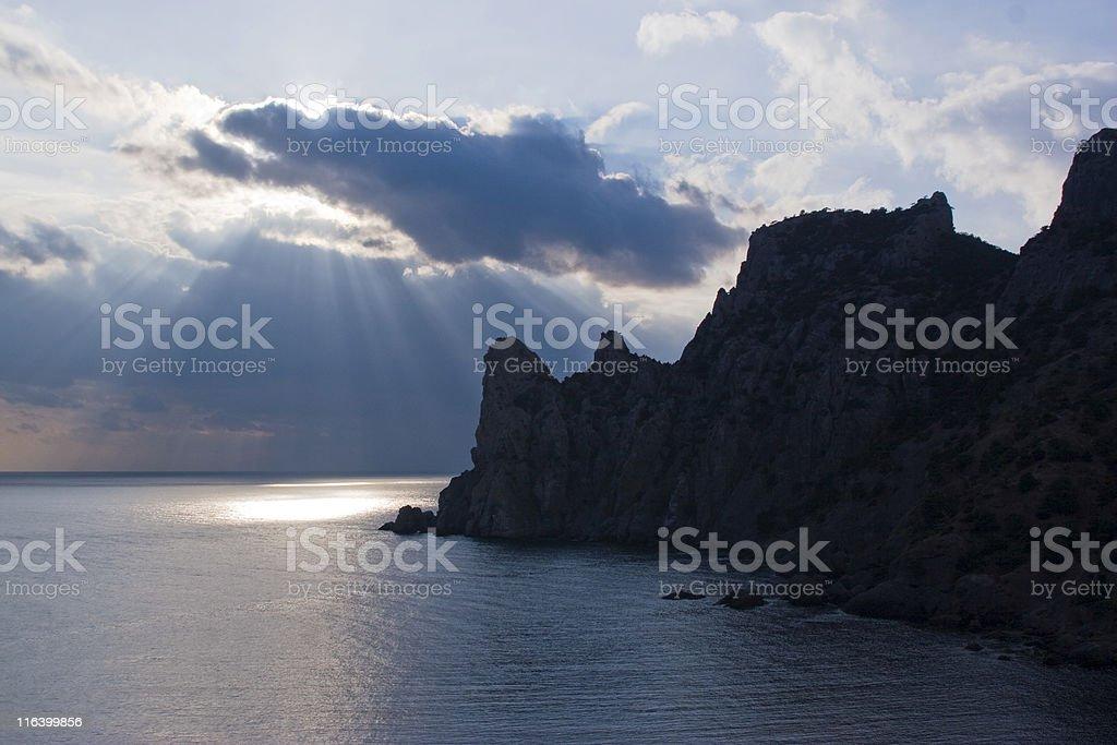 sunbeams on sunset above sea stock photo