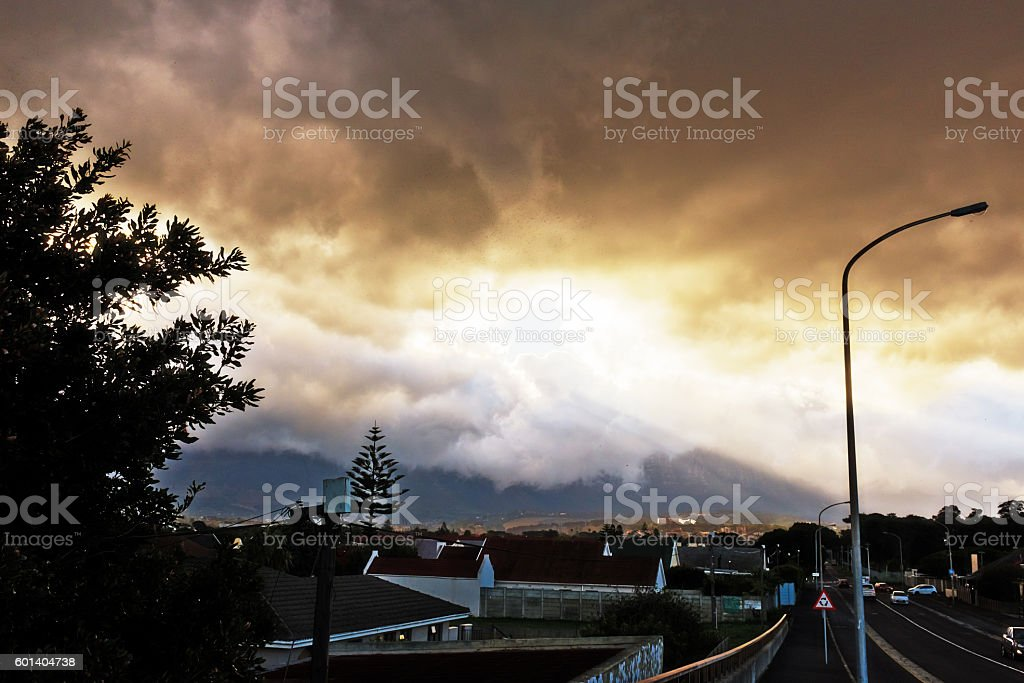 Sunbeams over Cape Town southern suburbs stock photo