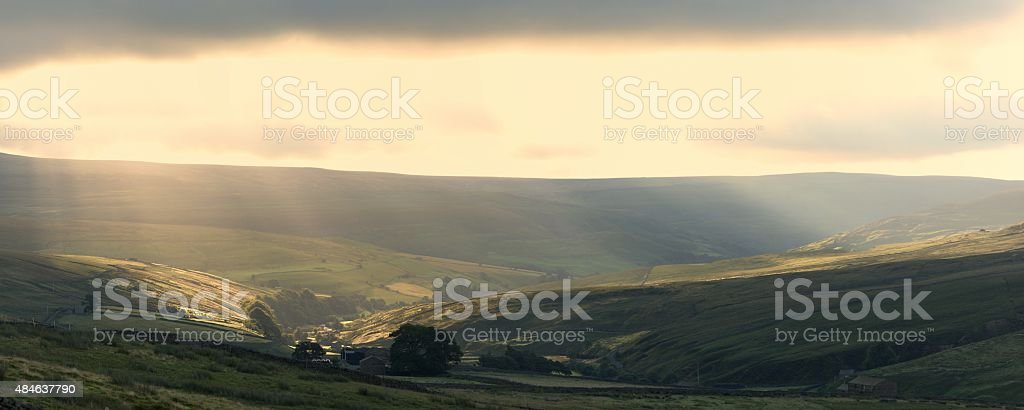 Sunbeams over upper Swaledale stock photo