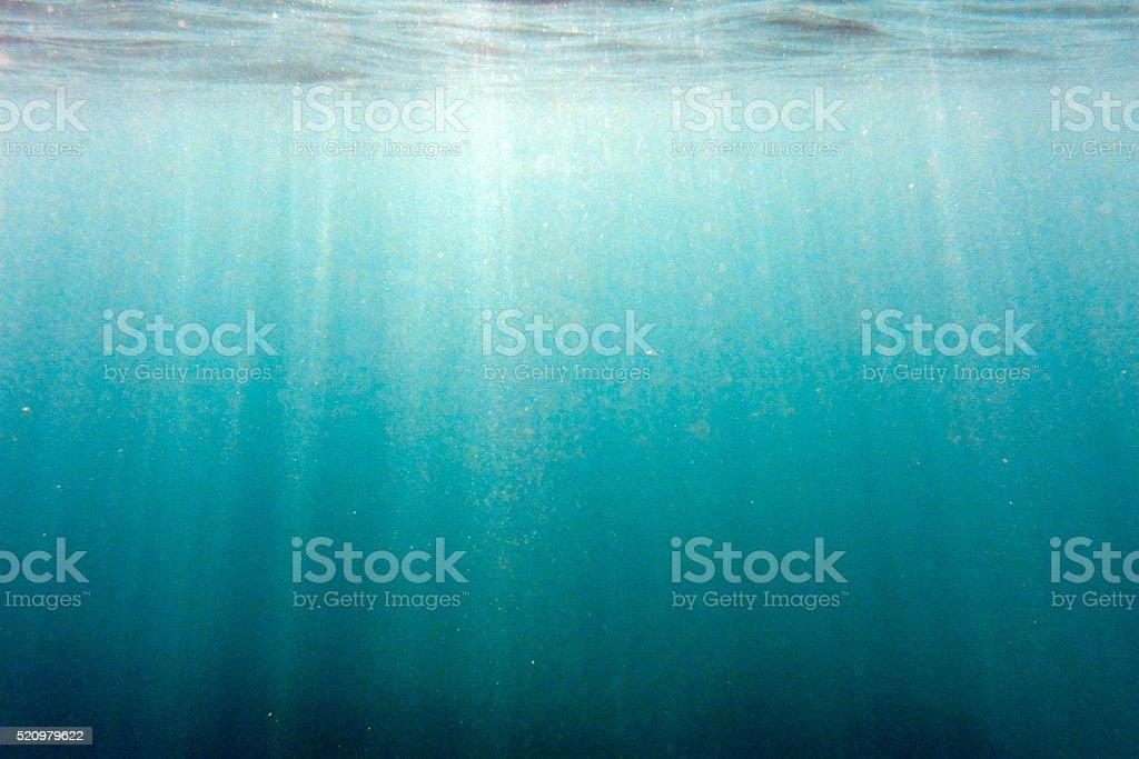 Sunbeams shining underwater stock photo