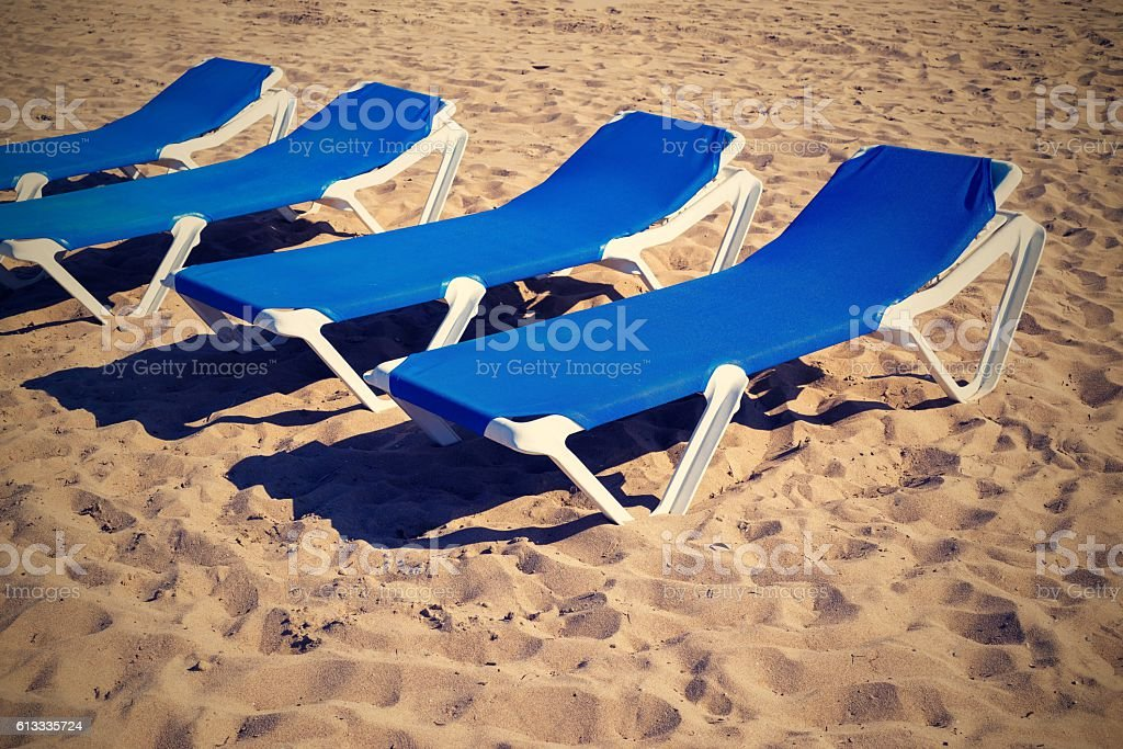 sunbed closeup on beach in a retro color stock photo