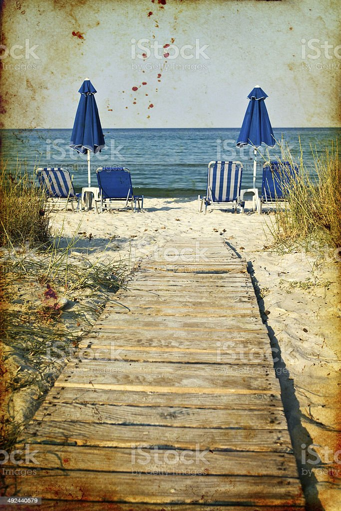 Sunbeds and umbrellas on the beach royalty-free stock photo