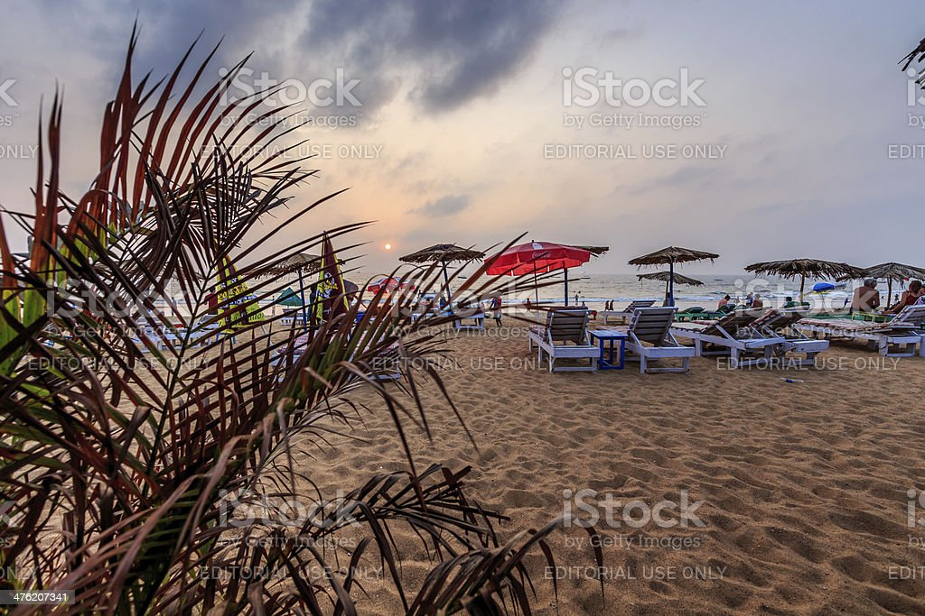 sunbeds in cloudy sunset stock photo