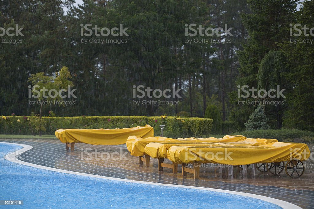 Sunbeds in the rain stock photo
