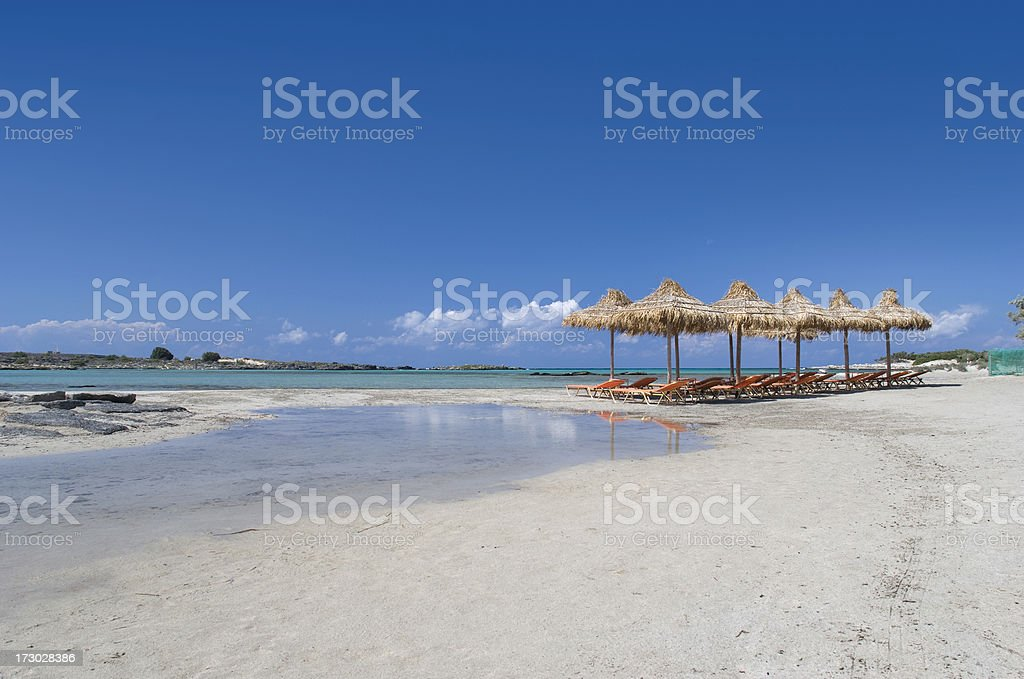 'Sunbeds on the Crete island, Greece' stock photo
