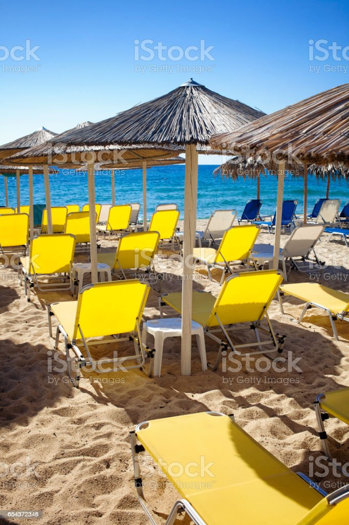 Sunbeds with parasols on the beach stock photo