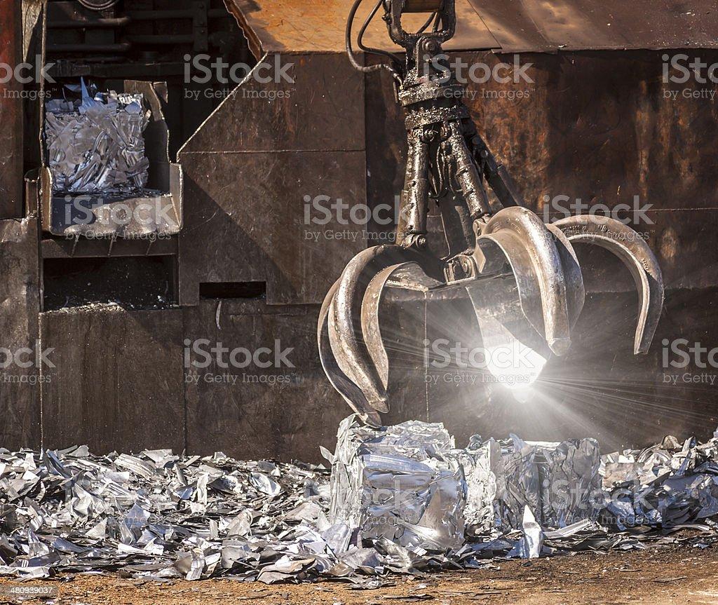 Sunburst on giant recycling claw stock photo