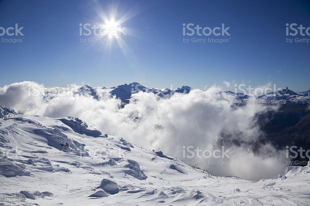 Sunburst Over Mist and Mountains stock photo
