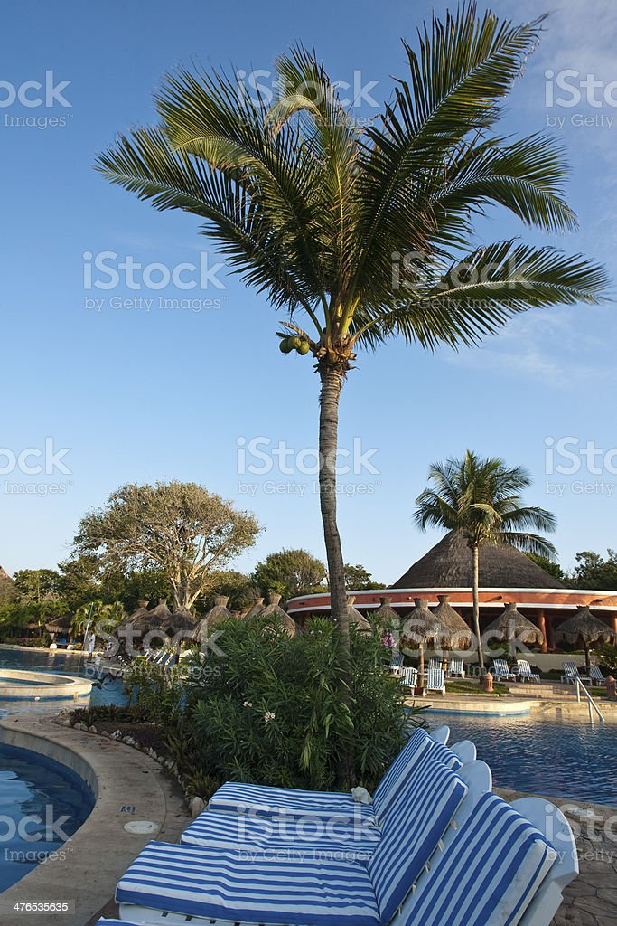 Sun-chaira on resorts pool side stock photo