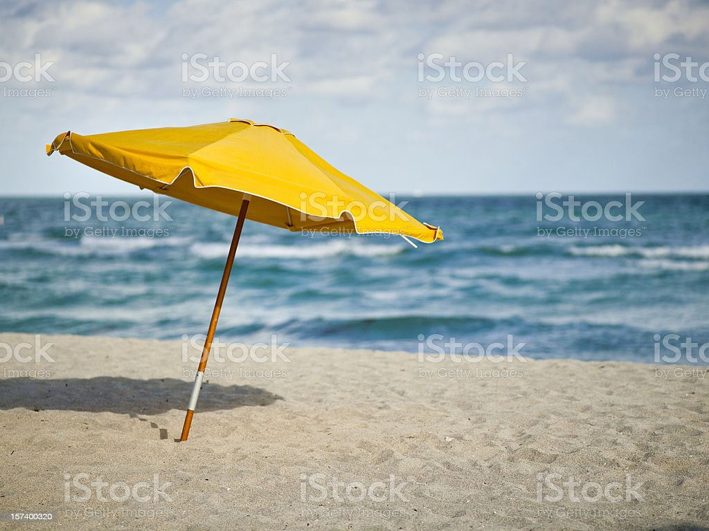 Sunchairs and umbrella on Beach stock photo