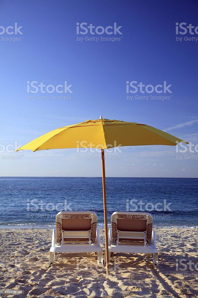 Sunchairs and umbrella on Carribean Beach royalty-free stock photo