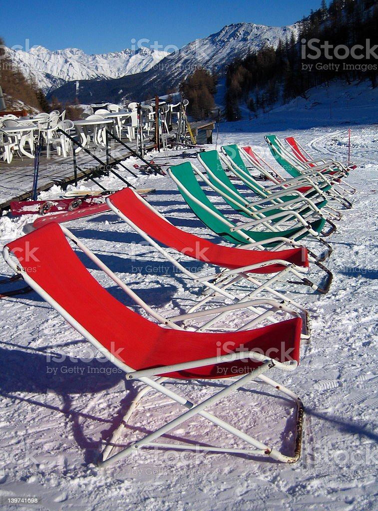 Sunchairs in the snow royalty-free stock photo