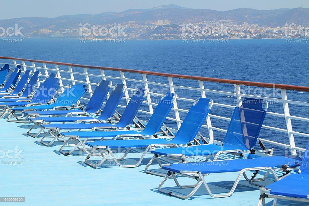 sunchairs on a cruise ship stock photo