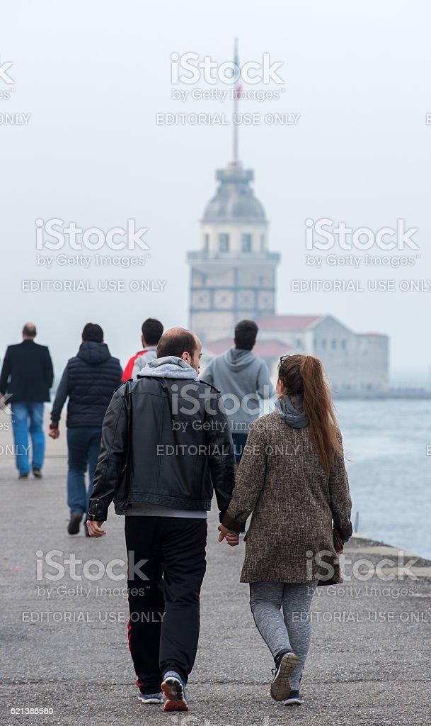Sunday morning walk near bosphorus - Kiz Kulesi stock photo