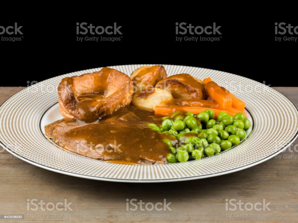 Sunday Roast Lunch or Dinner of Roast Beef and Yorkshire Pudding stock photo