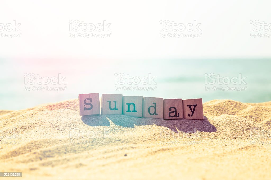 Sunday word on sea beach in retro style stock photo