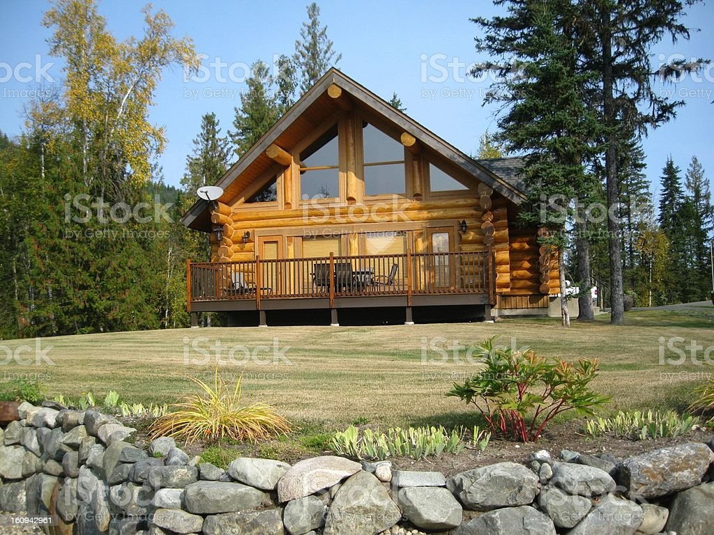Sundeck on log cabin stock photo