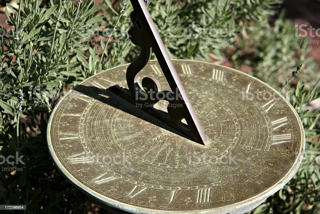Sundial casts a shadow stock photo