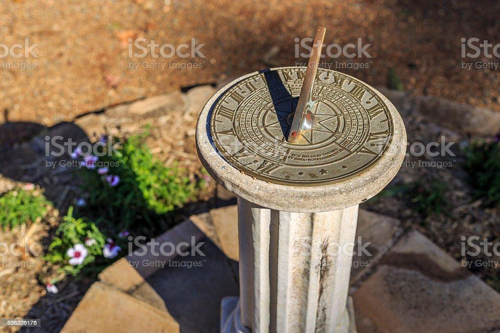 Sundial in the botanical gardens. stock photo