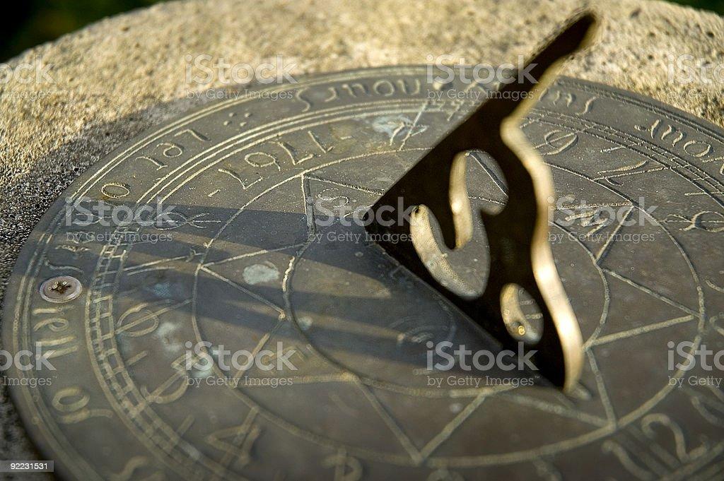 Sundial in the evening sun stock photo