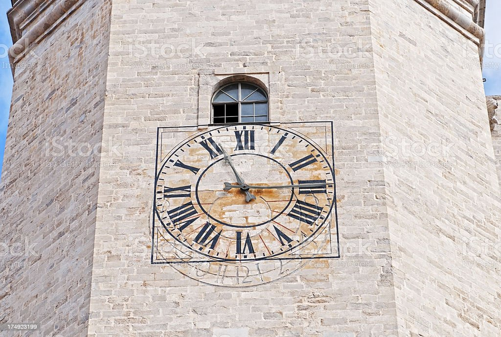 Sundial replaced by clock on cathedral tower in Spain stock photo