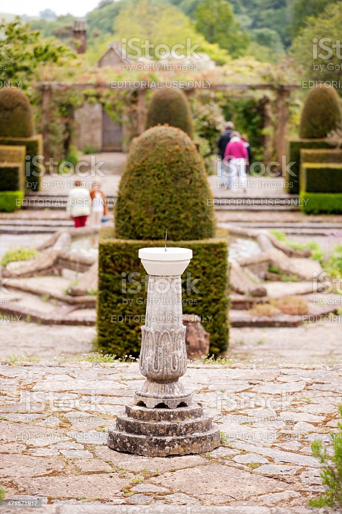 Sundial with topiary garden stock photo