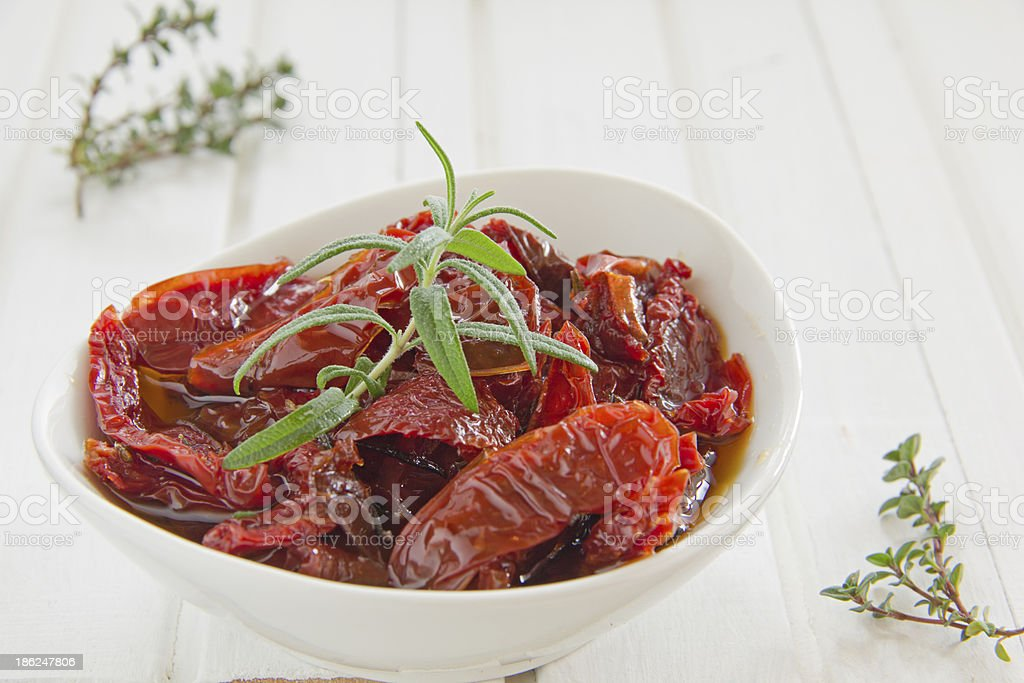 Sun-dried tomatoes with thyme. stock photo