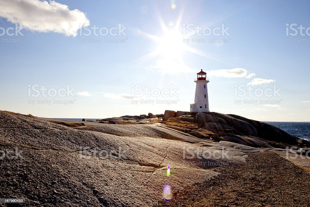 Sunflare over Peggy's Cove stock photo