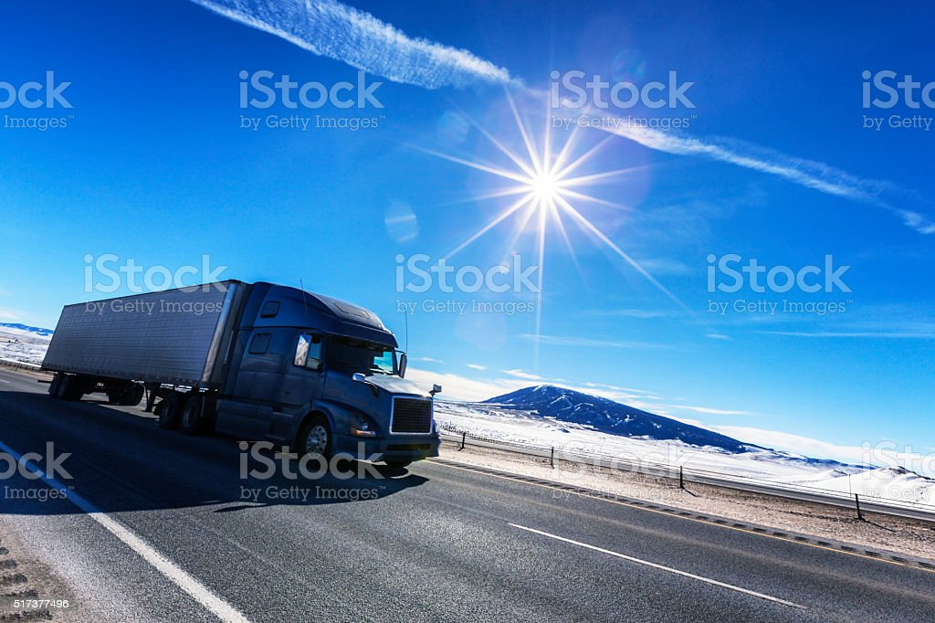 Sunflare Semi Trailer Truck Driving on Western USA Expressway stock photo