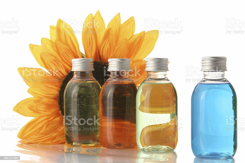 Sunflower and soap bottles royalty-free stock photo