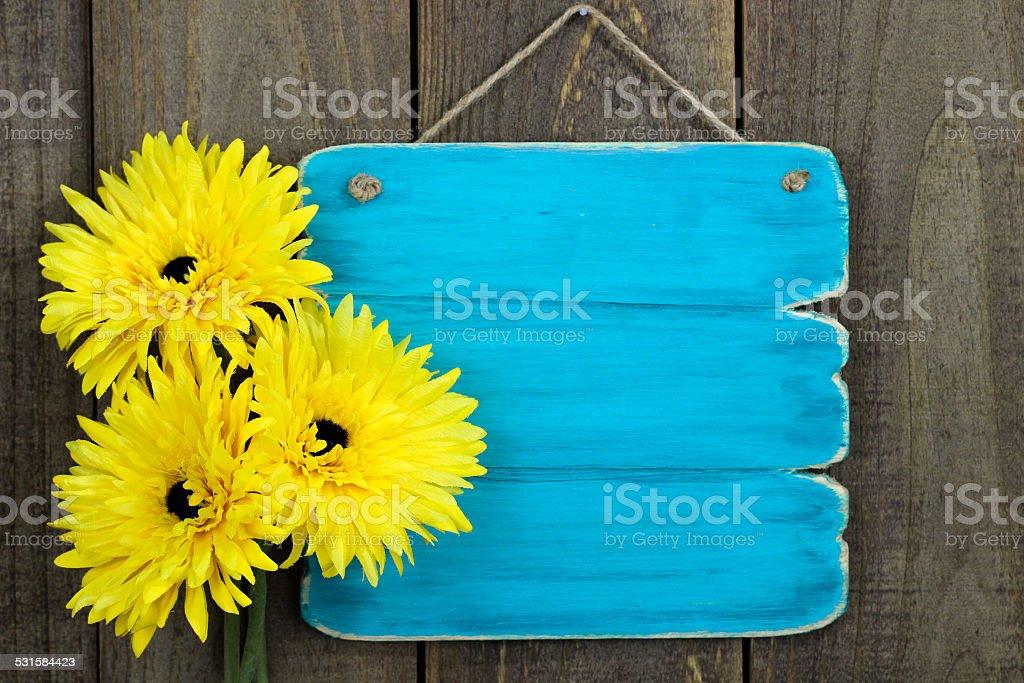 Sunflower border on blank blue sign stock photo