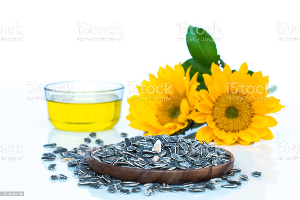 Sunflower, oil and seeds on white background. stock photo