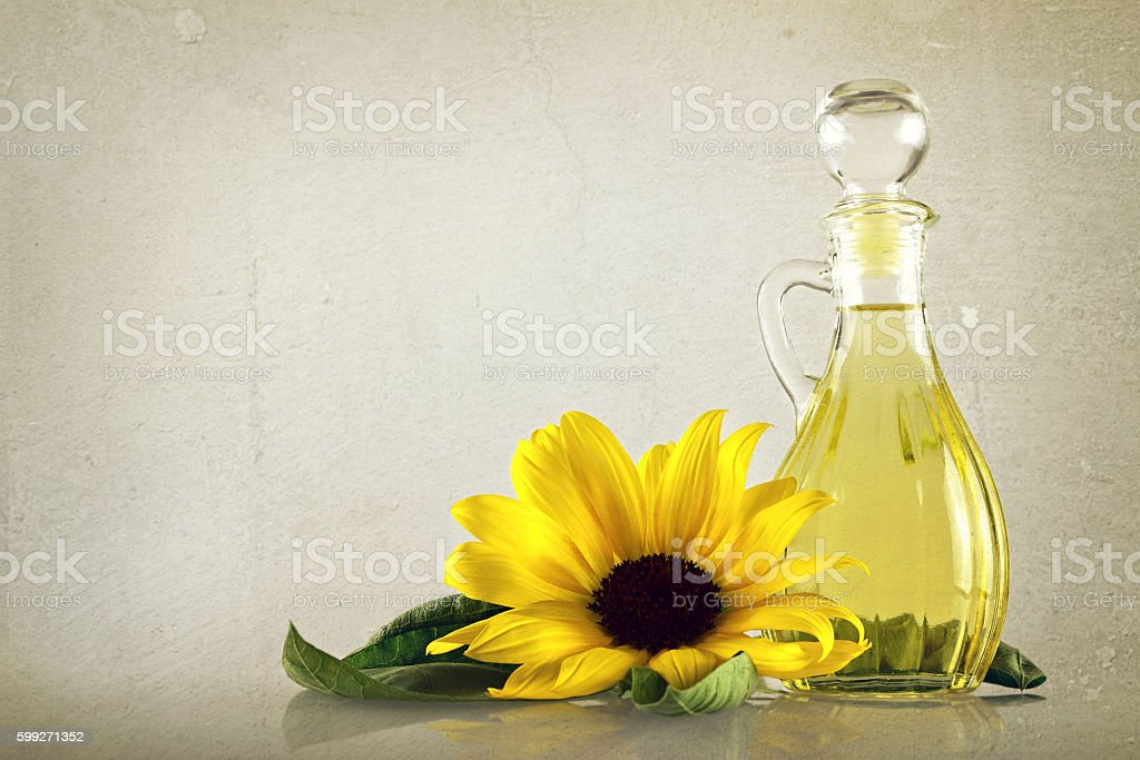 Sunflower oil in a decanter on grunge background stock photo