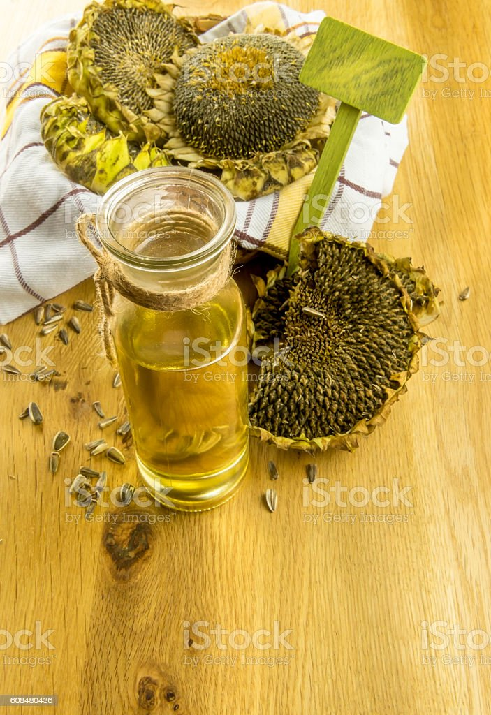 Sunflower plants and a bottle with oil stock photo