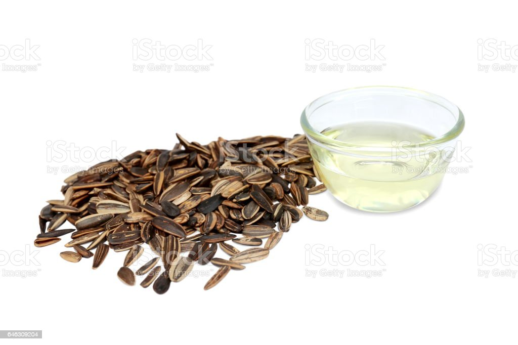 Sunflower seed and oils isolated on white background. stock photo