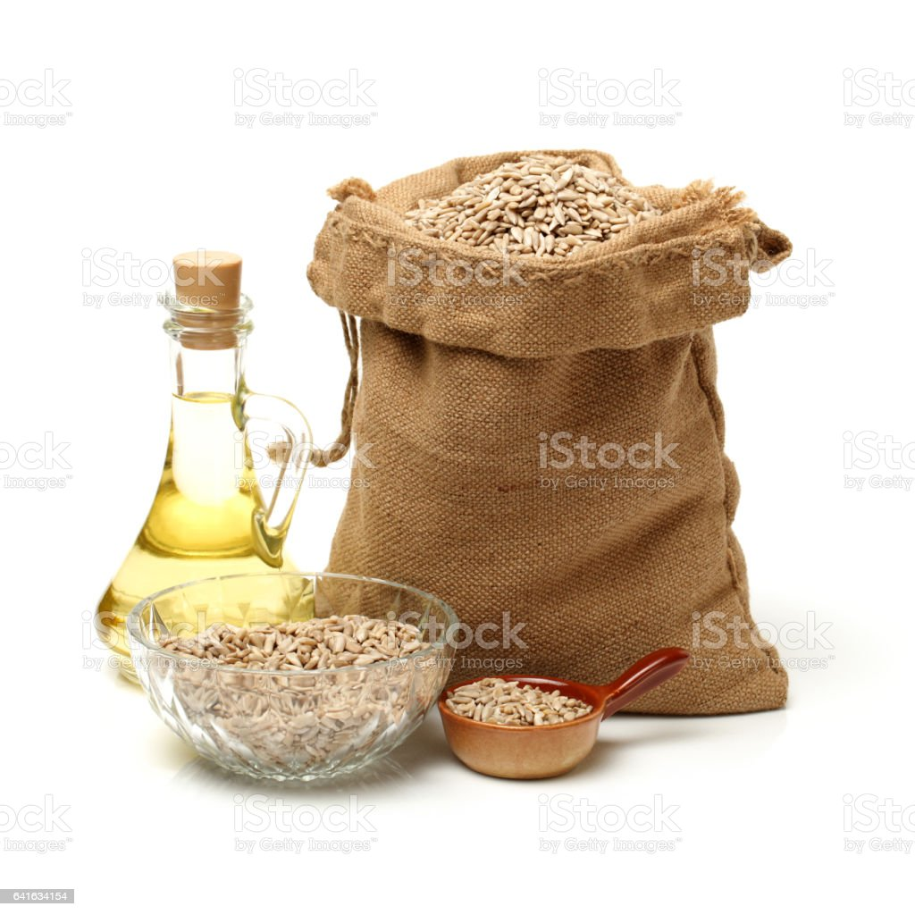 Sunflower seed oil in clear jar with cork top stock photo