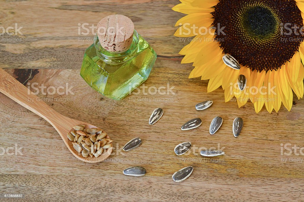 Sunflower seeds and oil stock photo