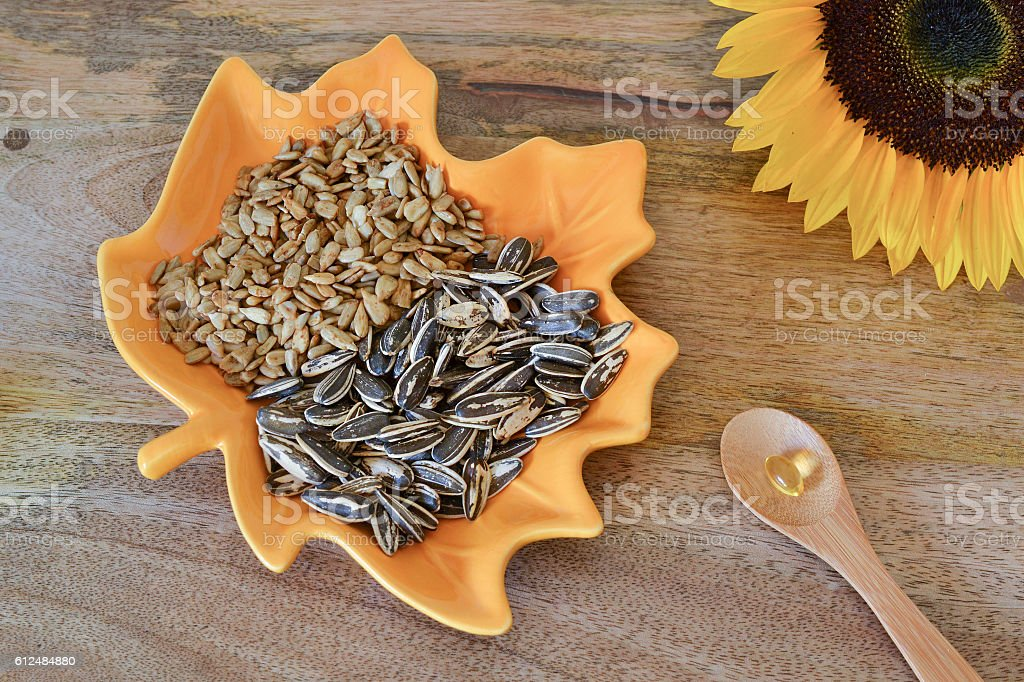 Sunflower seeds and vitamin E supplement stock photo