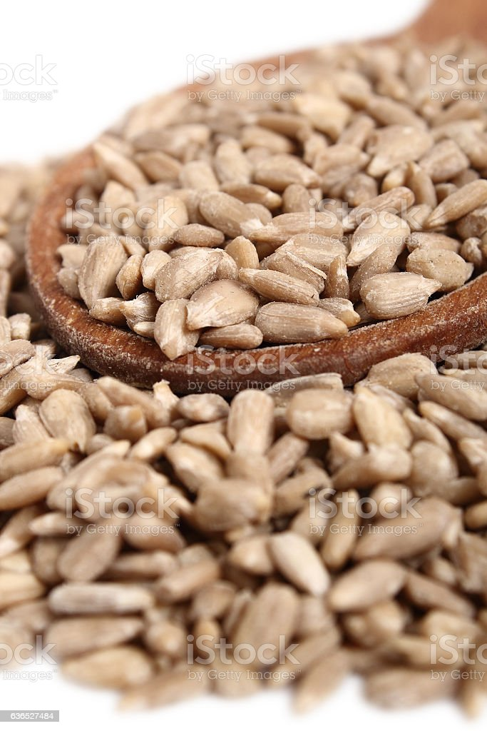Sunflower seeds on wooden spoon stock photo