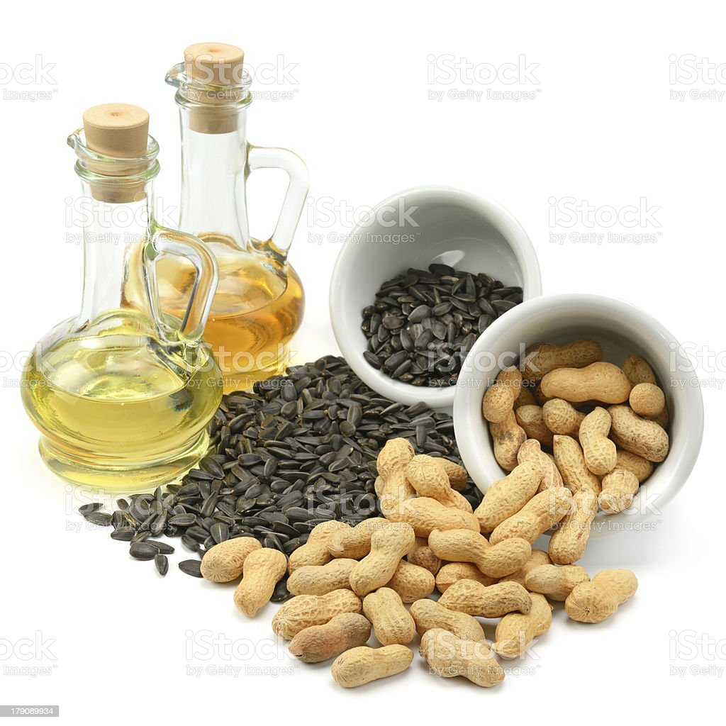 Sunflower seeds, peanuts and oil royalty-free stock photo