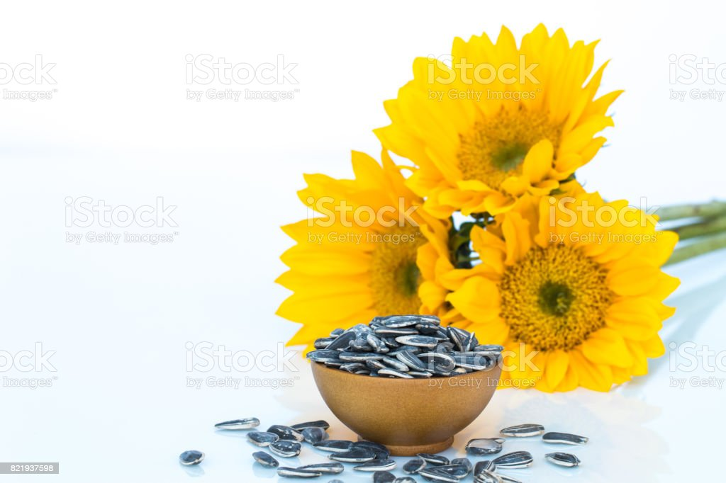 Sunflowerand and seeds on white background. stock photo