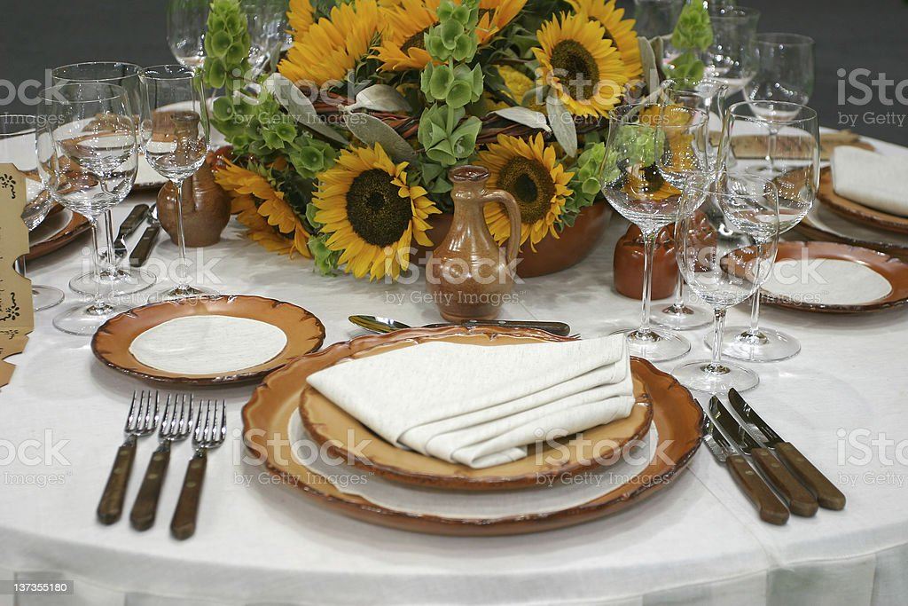 Sunflowers on a prepared table stock photo