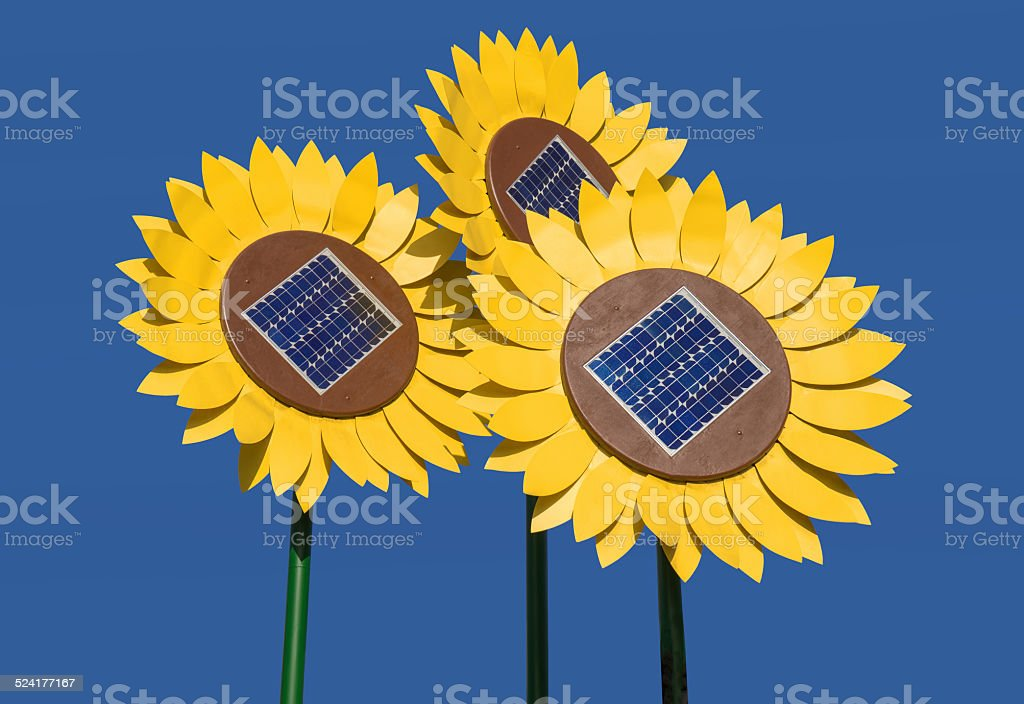 Sunflowers with solar cells royalty-free stock photo